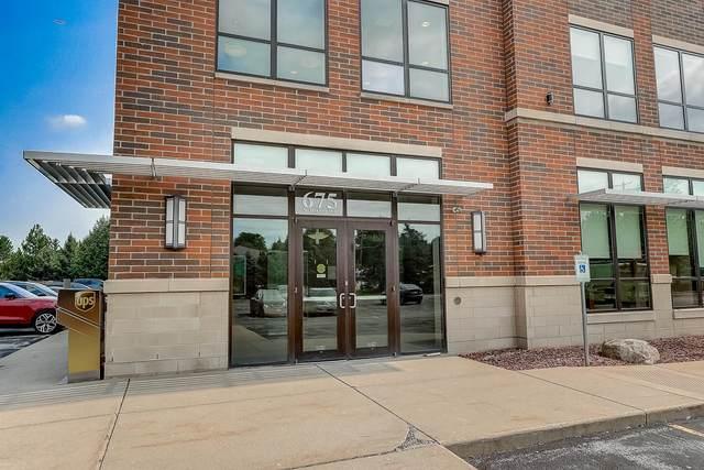 675 N Barker Rd #11, Brookfield, WI 53045 (#1711049) :: Tom Didier Real Estate Team