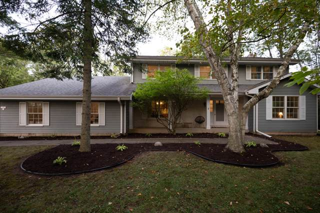 10838 N San Marino Dr, Mequon, WI 53092 (#1711400) :: RE/MAX Service First Service First Pros