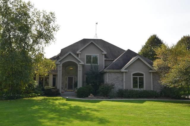3650 Cedar Creek Ct, Polk, WI 53037 (#1711461) :: RE/MAX Service First Service First Pros
