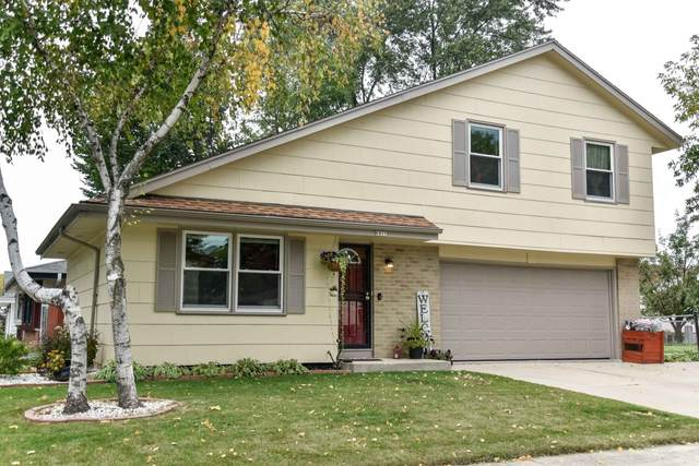 6911 N 78th St, Milwaukee, WI 53223 (#1711692) :: Tom Didier Real Estate Team