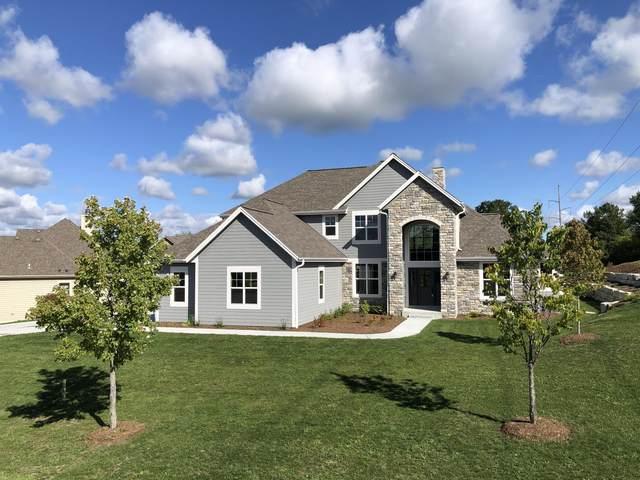566 Birchwood Dr, Hartland, WI 53029 (#1711743) :: OneTrust Real Estate