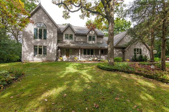 35060 Old Woods Rd, Summit, WI 53066 (#1712553) :: Tom Didier Real Estate Team