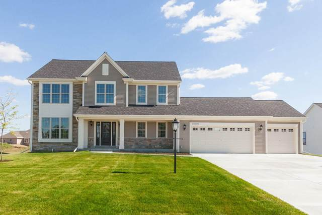 W222N4700 Seven Oaks Dr, Pewaukee, WI 53072 (#1712950) :: RE/MAX Service First