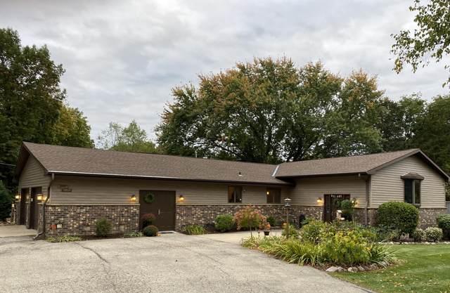 N46W32760 Oakwood Ave, Nashotah, WI 53058 (#1713011) :: Tom Didier Real Estate Team