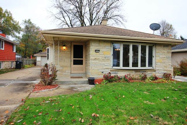 9827 W Grantosa Dr, Wauwatosa, WI 53222 (#1717026) :: Tom Didier Real Estate Team