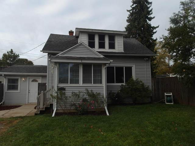 4722 W Mill Rd, Milwaukee, WI 53218 (#1717085) :: RE/MAX Service First Service First Pros