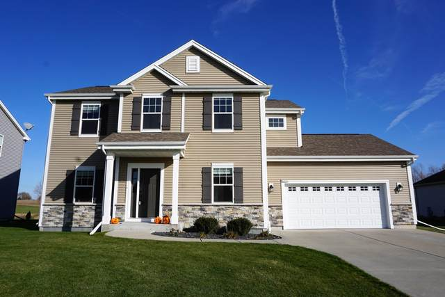 N8292 Woody Ln, Ixonia, WI 53036 (#1717558) :: RE/MAX Service First