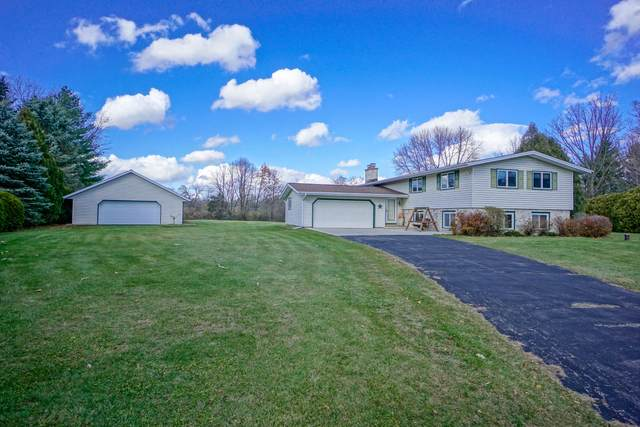 W319 Golden Lake Park Cir, Concord, WI 53066 (#1718180) :: RE/MAX Service First