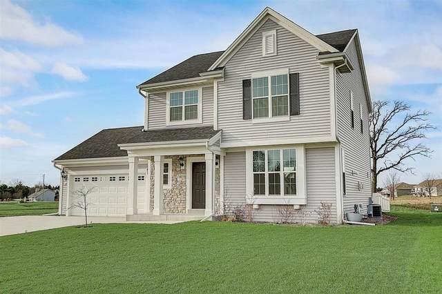 515 N Spur Rd, Slinger, WI 53086 (#1719473) :: Tom Didier Real Estate Team