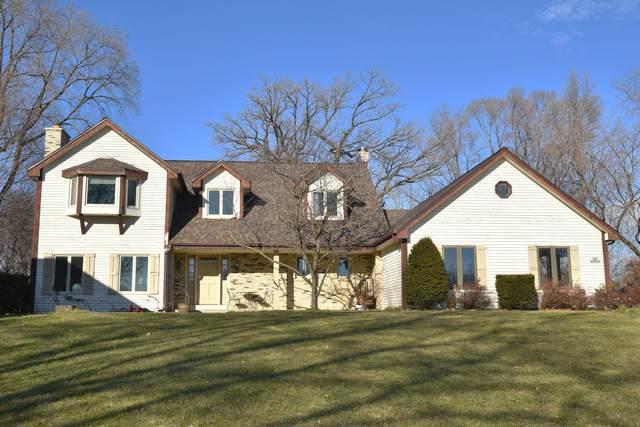 N28W22164 Indianwood Ct, Pewaukee, WI 53186 (#1720789) :: RE/MAX Service First