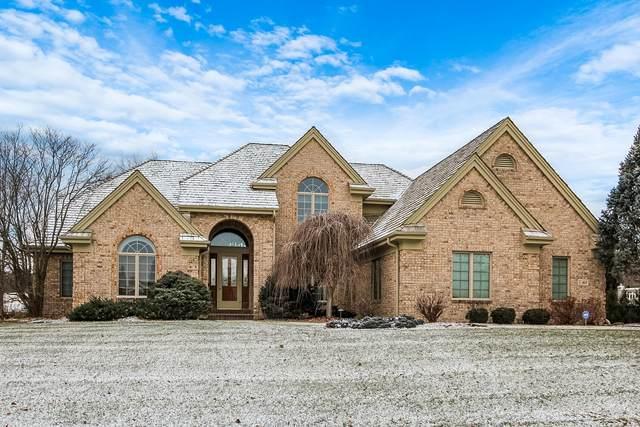 411 N Thornbush Cir, Hartland, WI 53029 (#1722695) :: Tom Didier Real Estate Team