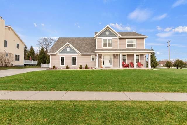 1204 Upper Greystone Dr, Plymouth, WI 53073 (#1722963) :: RE/MAX Service First