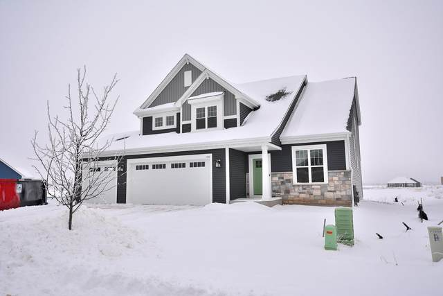 1390 Foxwood Pass, Oconomowoc, WI 53066 (#1723036) :: Tom Didier Real Estate Team