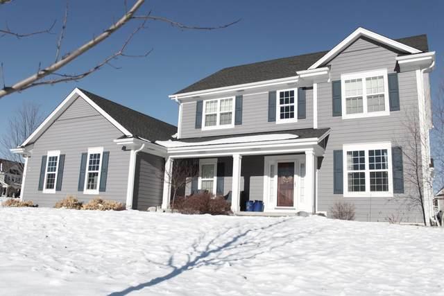 W78N408 Ridgeway Ln, Cedarburg, WI 53012 (#1724859) :: Tom Didier Real Estate Team