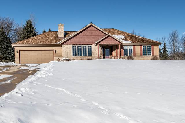6038 Leprechaun Ln, Erin, WI 53027 (#1724863) :: Tom Didier Real Estate Team