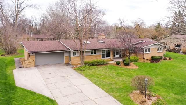 7890 N Mohawk Rd, Fox Point, WI 53217 (#1736373) :: Tom Didier Real Estate Team
