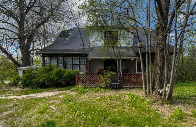 8345 N Granville Rd, Milwaukee, WI 53224 (#1740803) :: RE/MAX Service First