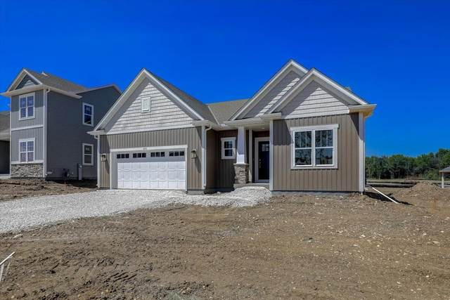 606 Scenic Rd, Hartland, WI 53029 (#1748132) :: Keller Williams Realty - Milwaukee Southwest
