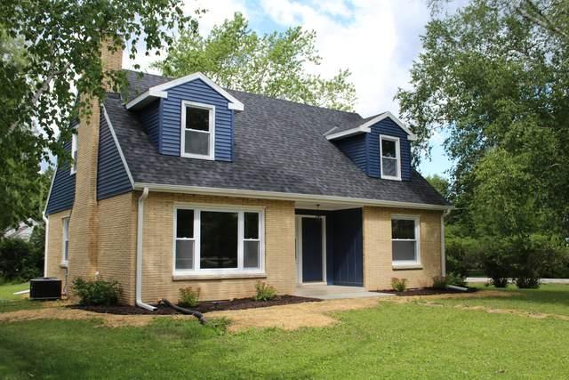 8341 N Links Way, Fox Point, WI 53217 (#1749161) :: Tom Didier Real Estate Team