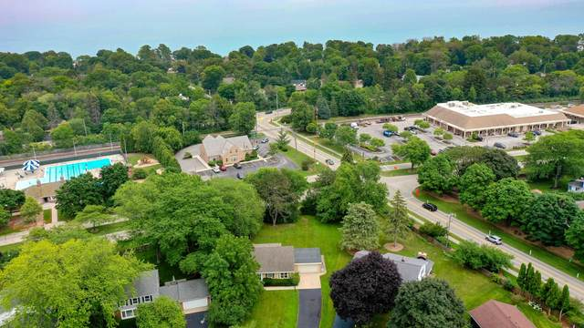 7009 N Lombardy Ct, Fox Point, WI 53217 (#1753144) :: RE/MAX Service First