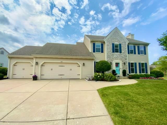 7957 S Lakeview Dr, Franklin, WI 53132 (#1754462) :: Tom Didier Real Estate Team