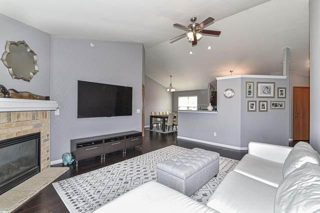 7005 W Rawson Ave, Franklin, WI 53132 (#1755283) :: Tom Didier Real Estate Team