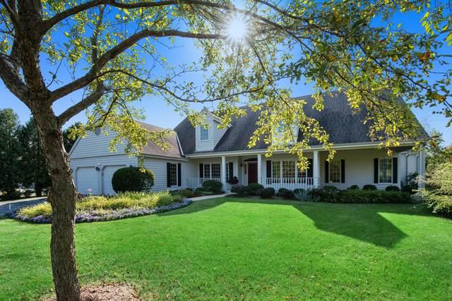 9645 N Columbia Creek Ln, Mequon, WI 53092 (#1760180) :: Tom Didier Real Estate Team