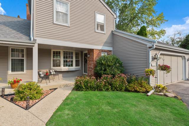 12565 N Woodberry Dr, Mequon, WI 53092 (#1762251) :: Tom Didier Real Estate Team
