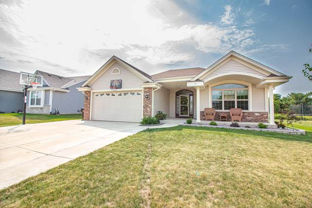 9131 Prairie Crossing Dr, Caledonia, WI 53126 (#1765093) :: EXIT Realty XL