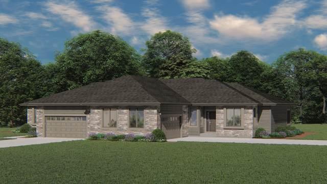 1000 N Pinegrove Ct #40, Hartland, WI 53029 (#1765339) :: Keller Williams Realty - Milwaukee Southwest
