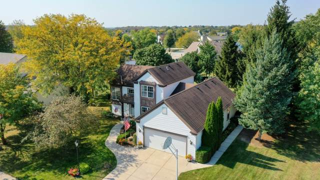 1231 Turnberry Dr, Pewaukee, WI 53072 (#1765982) :: RE/MAX Service First