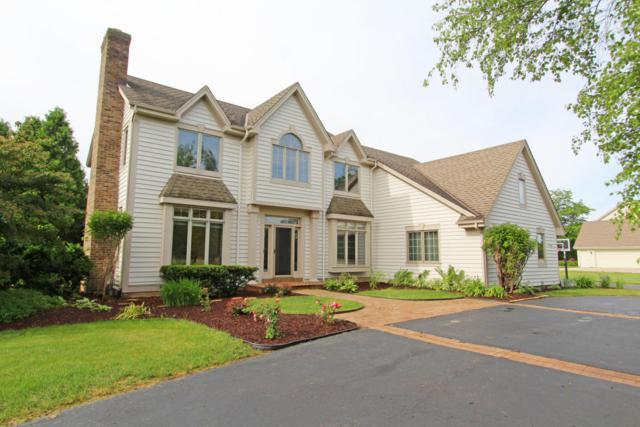 8705 W Bennington Ct, Mequon, WI 53097 (#1536778) :: Tom Didier Real Estate Team