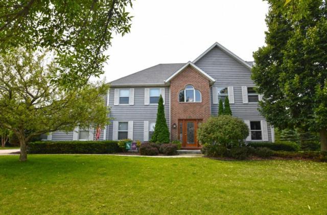 1180 Riverwalk Ct, Pewaukee, WI 53072 (#1541747) :: Vesta Real Estate Advisors LLC
