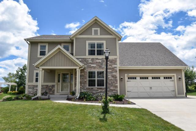 1848 Splitwood Dr, Port Washington, WI 53024 (#1551003) :: Tom Didier Real Estate Team
