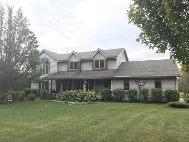 6593 Silver Shores Dr, Belgium, WI 53013 (#1554138) :: Tom Didier Real Estate Team