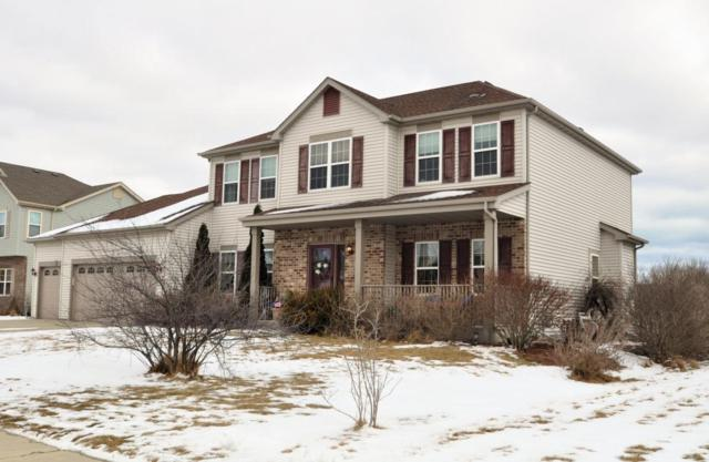 1176 Iris Ln, Saukville, WI 53024 (#1568901) :: Tom Didier Real Estate Team