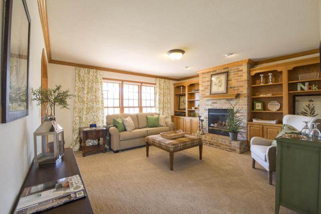 N54W16790 Ravenwood Dr, Menomonee Falls, WI 53051 (#1572334) :: Vesta Real Estate Advisors LLC