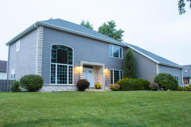 1290 W Violet Dr, Oak Creek, WI 53154 (#1601023) :: Vesta Real Estate Advisors LLC
