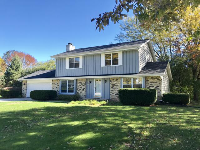 N81W14100 Titan Ct, Menomonee Falls, WI 53051 (#1607446) :: Tom Didier Real Estate Team