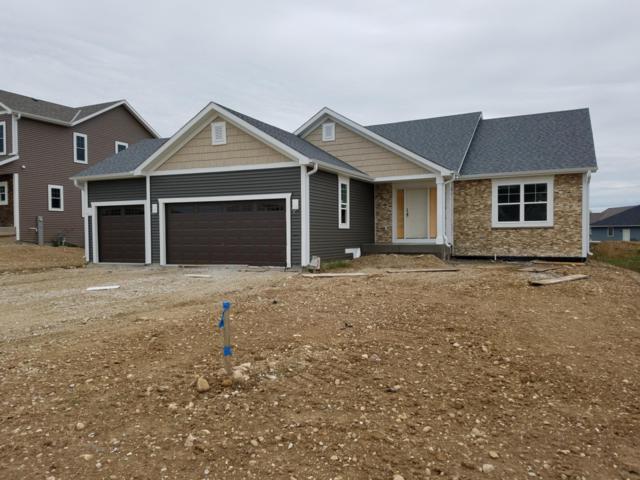 520 Spur Rd N, Slinger, WI 53086 (#1613653) :: Tom Didier Real Estate Team