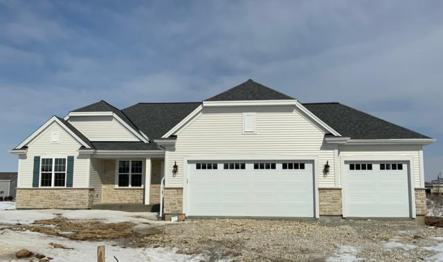 7957 N Forest Dr, Ixonia, WI 53036 (#1625060) :: Tom Didier Real Estate Team