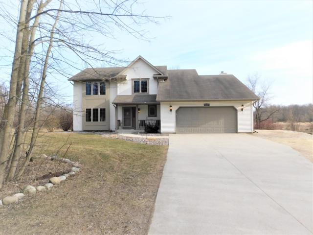 1214 Wisconsin St, Adell, WI 53001 (#1627640) :: RE/MAX Service First Service First Pros