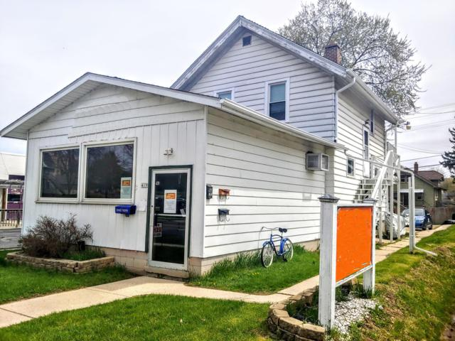 419 S Main St, West Bend, WI 53095 (#1635681) :: Tom Didier Real Estate Team