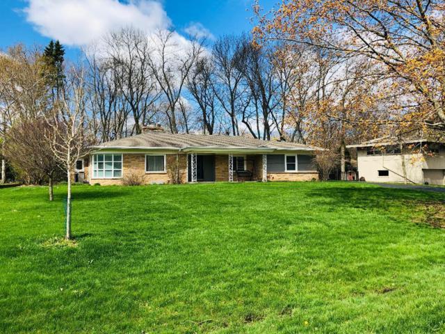 7047 N Crossway Rd, Fox Point, WI 53217 (#1639082) :: Tom Didier Real Estate Team