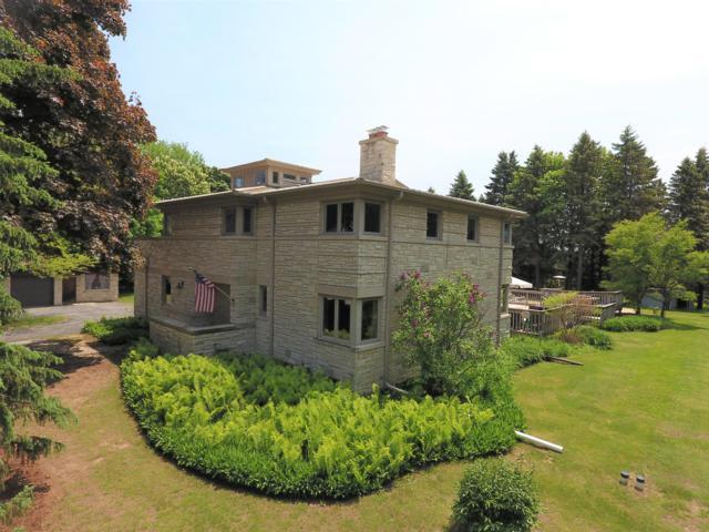 1549 Ulao Rd, Grafton, WI 53024 (#1640579) :: Tom Didier Real Estate Team