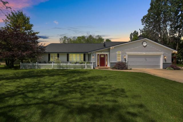 12049 N Lake Shore Dr, Mequon, WI 53092 (#1642638) :: Tom Didier Real Estate Team