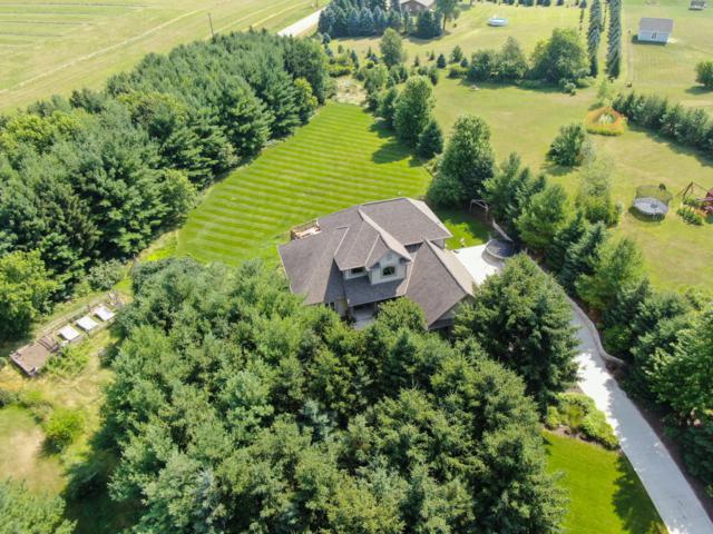 650 Pine Ter, Slinger, WI 53086 (#1648677) :: Tom Didier Real Estate Team
