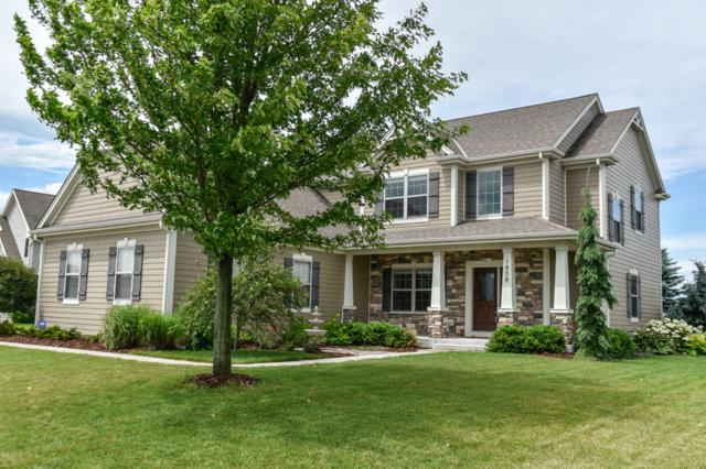 1808 River Lakes Rd S, Oconomowoc, WI 53066 (#1649050) :: RE/MAX Service First Service First Pros