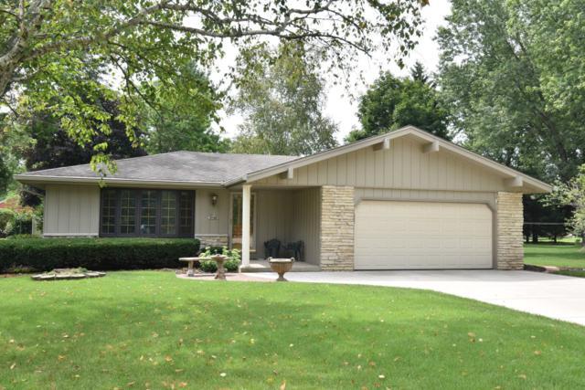 N59W35445 Surrey Dr, Oconomowoc, WI 53066 (#1652939) :: Tom Didier Real Estate Team
