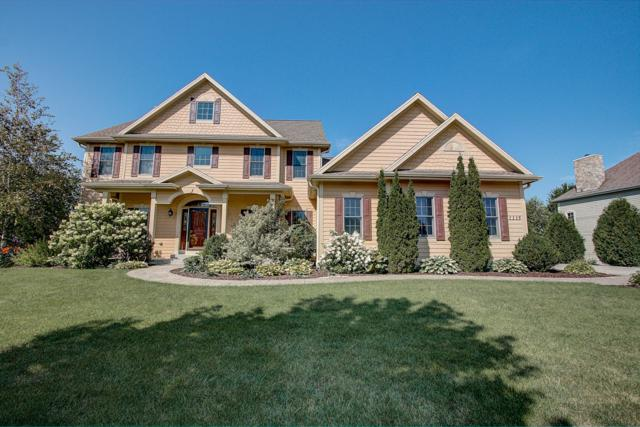 1115 Colonial Dr, Hartland, WI 53029 (#1652948) :: RE/MAX Service First